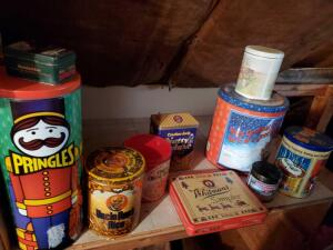 "A grouping of vintage ""tins,"" includes an uncle Ben's rice, ja folgers, and a box of holiday tins"