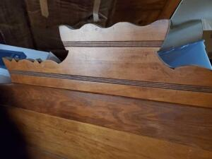 A vintage headboard, footboard, and mirror