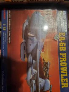 A big box with unopened model planes (1 ship), 2 opened