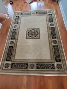 "A stunning ""like new"" to 90"" x 63"" area rug"