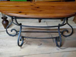 A very sturdy vintage half-moon sofa table with iron legs