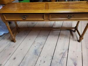 A vintage hammary 2-drawer sofa table