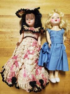 A pair of vintage possibly antique dolls whose eyes open and close.