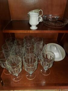 12 puratuff water glasses and other items in cabinet
