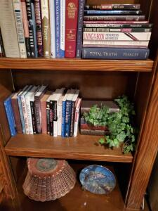 Two shelves of books and decorative items as pictured.