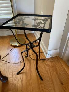A pair of Black and glass metal table