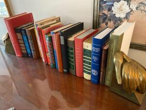 Grouping of books and pair of brass bookends