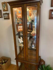 Glass front and side lighted, mirror back, curio cabinet