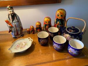 Grouping of decorative items with teapot and cups
