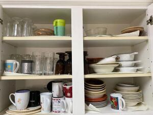 Assortment of dishes in cabinet: glasses bowls corning ware plates