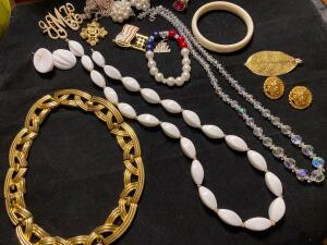 Collection of jewelry: necklace, earrings, bracelet, pendants