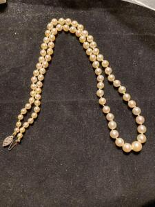 14 karat gold clasp and graduated size of pearl necklace
