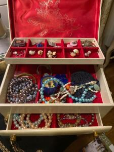 Jewelry box with necklaces, earrings, bracelets, pendants