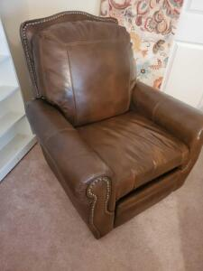 A haverty's recliner which appears to be fine leather