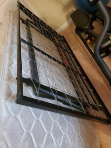 A twin size lift-trundle bed with 2 mattresses