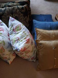 A grouping of 8 accent pillows