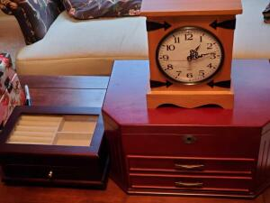 A pair of jewelry boxes and a desk clock