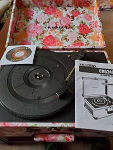 A crosley portable turntable, model cr6249A, and a grouping of albums