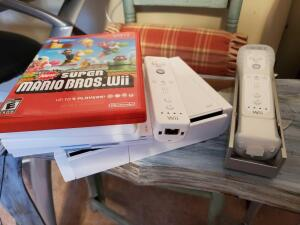 A ninento/Wii console and assories to include games