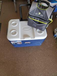 Coleman Xtreme 5-day cooler on wheels and a playmate personal cooler.