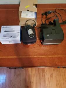 Web camera, Polaroid sun 600 instant camera, and brookstone pocket projector.
