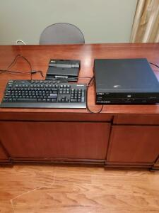 Lenovo keyboard, Apex DVD player, and Dell docking station.
