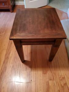 "End table measuring 24 x 21.5 x 23"" tall"