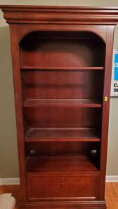 "Lighted bookcase with glass shelves and file drawer. Bookcase is 15.5 d x 39.5 w x 78"" tall."
