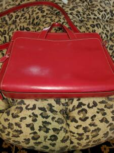 Red Samsonite messenger bag with removable shoulder strap.