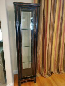 "Non lighted curio cabinet with three glass shelves. Cabinet is 18w x 16d x 74"" tall."