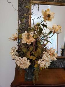 Pretty faux magnolia and hydrangea arrangement in black urn.