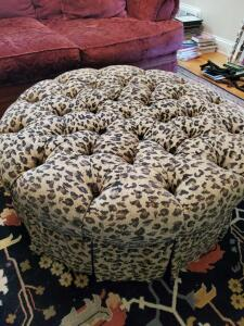 "Round tufted cheetah print ottoman with pleated skirt. Ottoman is 40"" round x 16"" tall."