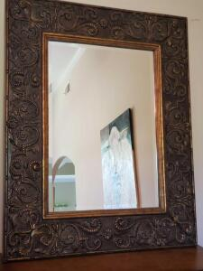 Framed mirror with beveled glass. 39 x 49.