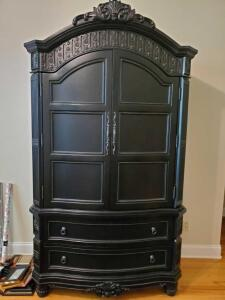 Beautiful Black entertainment cabinet with two drawers. Cabinet is 23 x 48 x85 tall.