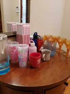 Grouping of plastic beverage wear, coffee mugs, pitcher, popcorn containers.