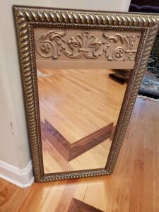 Gold framed, beveled mirror. 17.5 x 32 .5