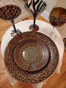 Animal print plates, martini glasses, and wine glass.