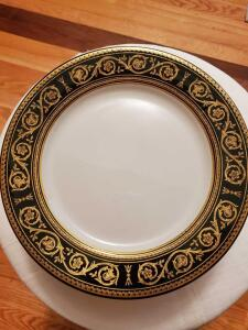 "Set of 7 shenango 10.5"" plates with black and gold border."
