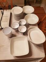 Grouping of white dishes and server ware.