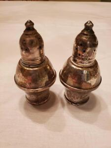 "Sterling salt and pepper shakers. 3.5"" tall."