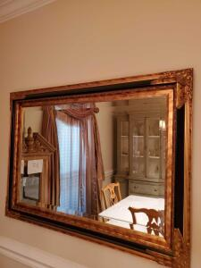 Ornately framed, beveled mirror. 43.5 x 31.5