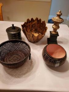 Decorative items in blacks, golds, and browns.
