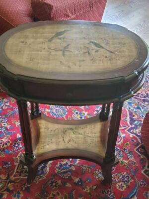 Vintage accent table with bird scenes etched