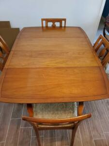 Drexel drop leaf table with a removable leaf and 4 chairs (1 is a captain), + protector