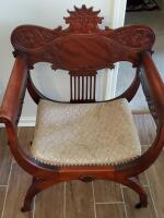 Antique wood carved, upholstered seat, chair on wheels