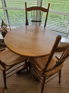 A vintage pie crust table and 3 chairs