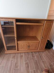 "Entertainment center on wheels, 52"" tall, 66"" across, 20"" front to back"