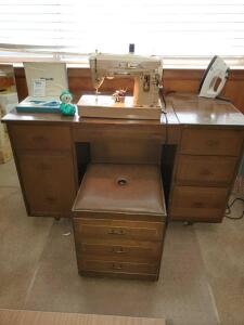 Vintage Singer sewing machine, cabinet, and all contents.