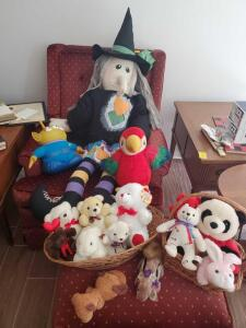 "A grouping of stuff animals and a 45"" witch"