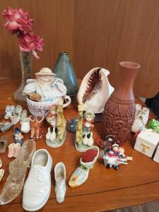 A large grouping of decorative items including a lot of porcelain/ceramic/glass shoes